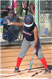 Softball player preparing to bat
